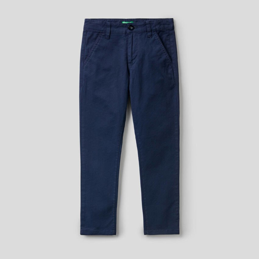 Trousers in printed stretch cotton
