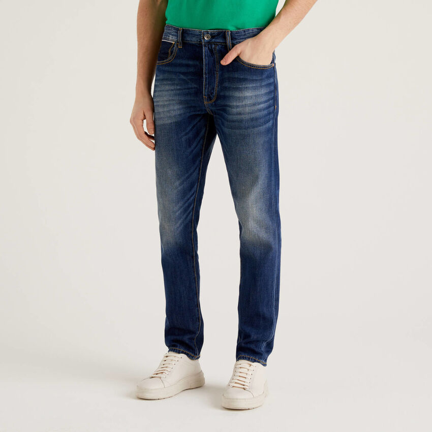 Five pocket jeans with worn look