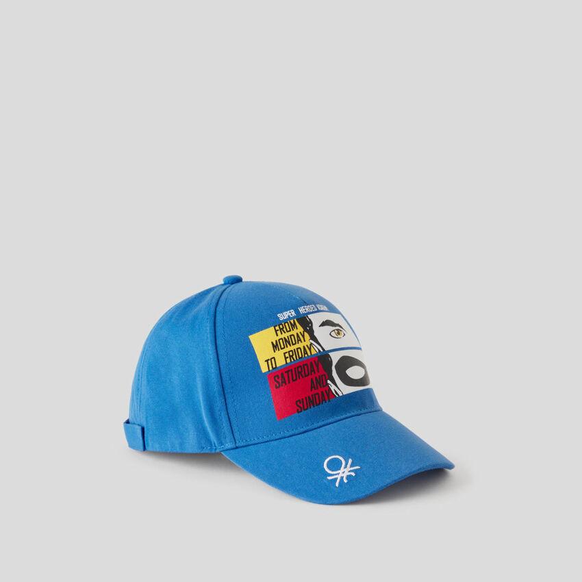 Blue cap with multicolor print